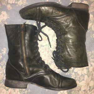 Black Steve Madden boots.